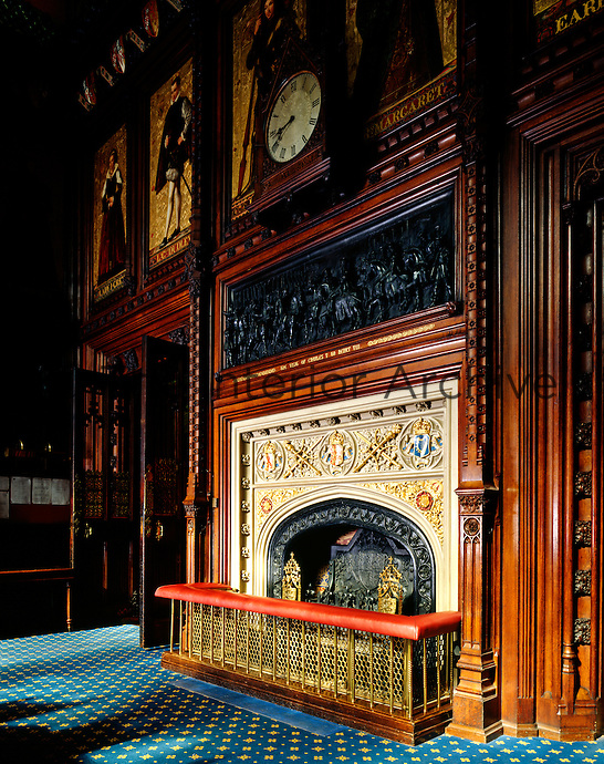 The fireplace in the Prince's Chamber, above which is mounted one of the bronze reliefs by William Theed, which decorate the walls of the room