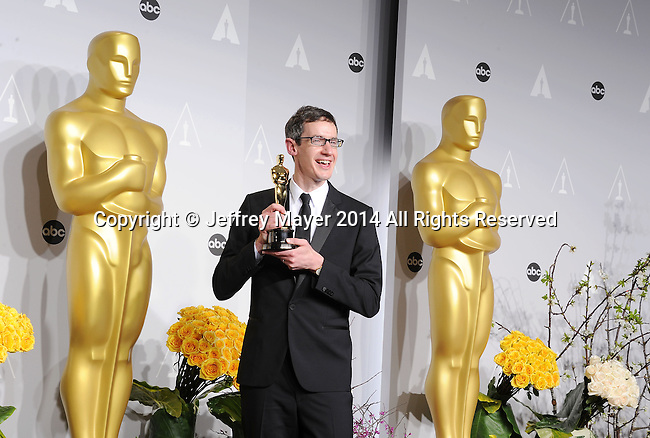 HOLLYWOOD, CA- MARCH 02: Composer Steven Price, winner of Best Achievement in Music Written for Motion Pictures, Original Score poses in the press room during the 86th Annual Academy Awards at Loews Hollywood Hotel on March 2, 2014 in Hollywood, California.