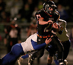 HOWARD, SD - NOVEMBER 8:  Luke Loudenburg #23 from Howard tries to slip the grasp of Colin Walth #32 from Alcester Hudson in the first half of their Class 9A Semifinal game Saturday night in Howard. (Photo by Dave Eggen/Inertia)
