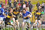 Pa Sheehan Laune Rangers under pressure from Chris Brady, Colm Cooper and Daithi Casey during their Club Championship semi final in Killarney on Sunday