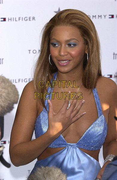 "BEYONCE KNOWLES.at launch of new Tommy Hilfiger fragrance ""True Star"" inspired by Beyonce.half length cross crucifix hand, gesture, blue eyeshadow, make-up, bra top.www.capitalpictures.com.sales@capitalpictures.com.©Capital Pictures"