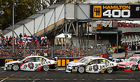 Jim Beam Racing's Steven Johnson (left) and James Courtney (centre) lead Race Two with Steven Richards (obscured) and Jamie Whincup (right) early in the race during Day Three of the Hamilton 400 Aussie V8 Supercars Round Two at Frankton, Hamilton, New Zealand on Sunday, 19 April 2009. Photo: Dave Lintott / lintottphoto.co.nz