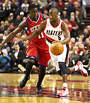 12/26/11--Trail Blazers guard Raymond Felton brings the ball upcourt against 76ers' Jrue Holliday in the home-opener at the Rose Garden...Photo by Jaime Valdez. .........................................