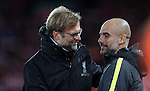 Jurgen Klopp manager of Liverpool and Manchester City Manager Pep Guardiola before the English Premier League match at Anfield Stadium, Liverpool. Picture date: December 31st, 2016. Photo credit should read: Lynne Cameron/Sportimage