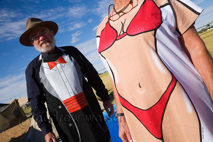 Race goers in novelty dress for the annual Birdsville Races.  Every September thousands of revellers arrive in the remote outback town, on the edge of the Simpson Desert, for the most famous horse racing carnival in outback Australia.  Birdsville, Queensland, AUSTRALIA.