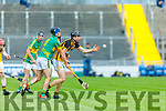 Abbeydorney's Jamesie O'Connor hand passes the sliotar out of danger despite the tackle from Lixnaw's Jeremy McKenna in the Senior Hurling Championship quarter final.