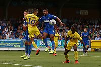 Joe Pigott of AFC Wimbledon Matt Bloomfield of Wycombe Wanderers Kwesi Appiah of AFC Wimbledon and Anthony Stewart of Wycombe Wanderers during AFC Wimbledon vs Wycombe Wanderers, Sky Bet EFL League 1 Football at the Cherry Red Records Stadium on 31st August 2019