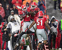 ATHENS, GA - OCTOBER 19: Richard LeCounte #2 and Monty Rice #32 of the Georgia Bulldogs celebrate LeCounte's fumble recovery during a game between University of Kentucky Wildcats and University of Georgia Bulldogs at Sanford Stadium on October 19, 2019 in Athens, Georgia.