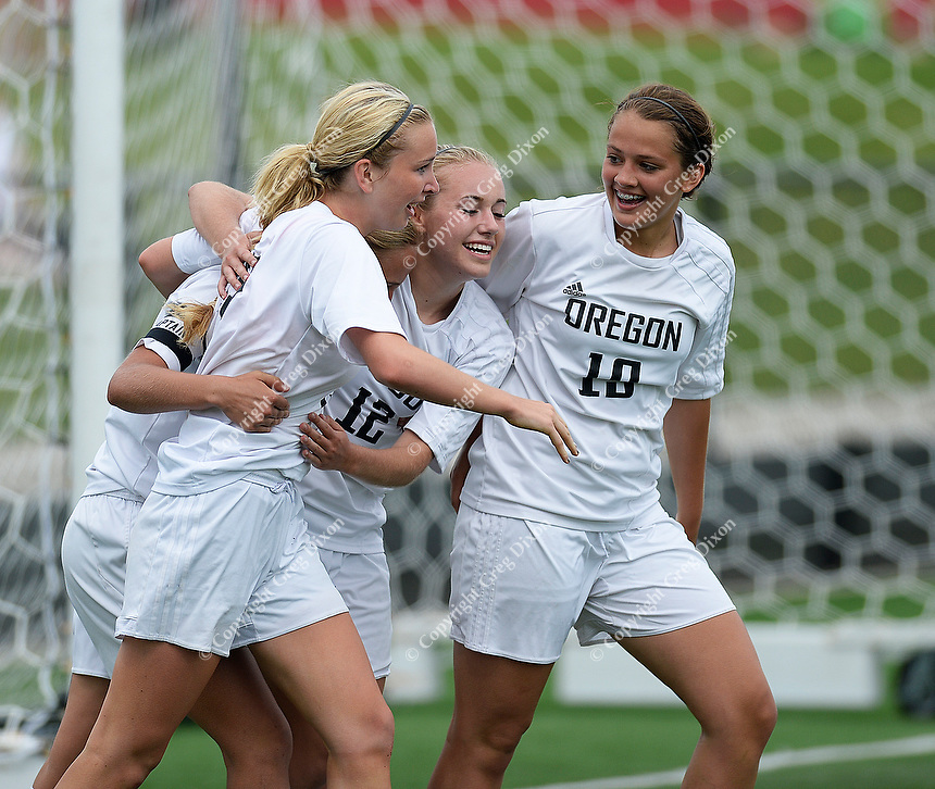 Oregon's Jen Brien (left) celebrates her game winning goal with Madelyn Peach (12) and Brittyn Fleming (right), as Oregon tops Green Bay Southwest 3-0 to win the WIAA Division 2 girls soccer state championship, on Saturday, June 20, 2015 at Uihlein Soccer Park in Milwaukee, Wisconsin