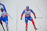 HOLMENKOLLEN, OSLO, NORWAY - March 16: (L-R) Giorgio di Centa of Italy (ITA) and Konstantin Glavatskikh of Russia (RUS) cross the finish line at the Men 50 km mass start, free technique, at the FIS Cross Country World Cup on March 16, 2013 in Oslo, Norway. (Photo by Dirk Markgraf)
