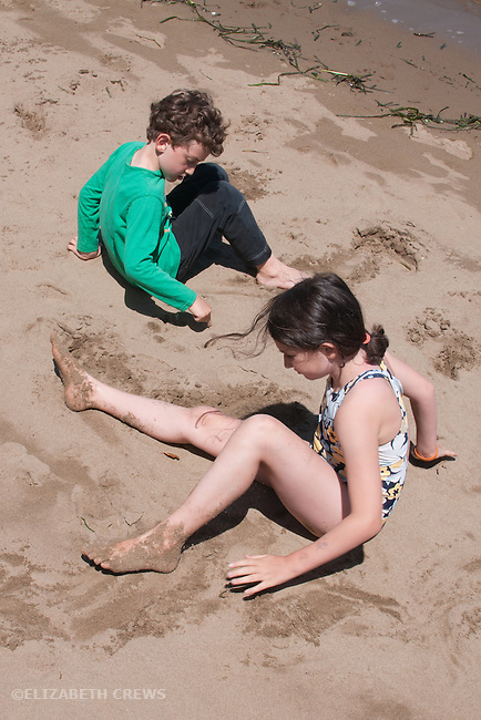 Angel Island CA Siblings, 6 & 8, enjoying sand on California beach MR