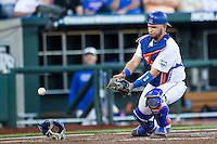 Florida Gators catcher Mike Rivera (4) drops a foul pop against the Miami Hurricanes in the NCAA College World Series on June 13, 2015 at TD Ameritrade Park in Omaha, Nebraska. Florida defeated Miami 15-3. (Andrew Woolley/Four Seam Images)