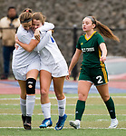 MIDDLETOWN, CT-111817JS31- Old Lyme's Britney DeRoehn (10) celebrates with teammate Mya Johnson (12) in front of Holy Cross' McKenna Ellsworth (2), after Johnson scored what would be the game- winning goal, in overtime during their Class S state final game Saturday at Middletown High School.<br /> Jim Shannon Republican-American