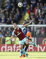 Burnley's Jack Cork vies for possession with Leicester City's Kelechi Iheanacho<br /> <br /> Photographer Rich Linley/CameraSport<br /> <br /> The Premier League - Burnley v Leicester City - Saturday 14th April 2018 - Turf Moor - Burnley<br /> <br /> World Copyright &copy; 2018 CameraSport. All rights reserved. 43 Linden Ave. Countesthorpe. Leicester. England. LE8 5PG - Tel: +44 (0) 116 277 4147 - admin@camerasport.com - www.camerasport.com