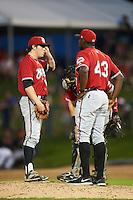 Carolina Mudcats relief pitcher Sean McLaughlin (11) talks with pitching coach Derrick Lewis (43) and catcher Joseph Odom during a game against the Frederick Keys on June 4, 2016 at Nymeo Field at Harry Grove Stadium in Frederick, Maryland.  Frederick defeated Carolina 5-4 in eleven innings.  (Mike Janes/Four Seam Images)