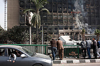 The ruling National Democratic party building burns the morning after being set on fire. Continued anti-government protests take place in Cairo calling for President Mubarak to stand down. After dissolving the government, Mubarak still refuses to step down from power. .