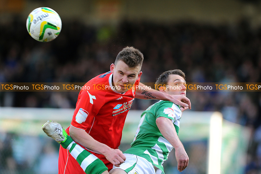 Andrew Butler of Walsall beats James Hayter of Yeovil Town to the ball - Yeovil Town vs Walsall - NPower League One Football at Huish Park, Yeovil, Somerset - 29/03/13 - MANDATORY CREDIT: Denis Murphy/TGSPHOTO - Self billing applies where appropriate - 0845 094 6026 - contact@tgsphoto.co.uk - NO UNPAID USE.