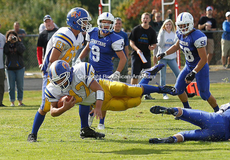 BURLINGTON, CT - 26 SEPTEMBER 2015 - 092615JW02.jpg -- Gilbert #42 Jake Roth leaps into the endzone aginst Lewis Mills at Lewis S. Mills Saturday afternoon. Jonathan Wilcox Republican-American