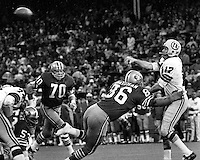 Washington Redskin's Billy Kilmore about to get hit by  San Francisco 49ers  Cedrick Hardman #70 Charlie Kruger..(Dec 26,1971 photo/Ron Riesterer)