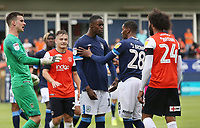 Huddersfield Town's Adama Diakhaby is held back by Jaden Brown after an altercation<br /> <br /> Photographer Rob Newell/CameraSport<br /> <br /> The EFL Sky Bet Championship - Luton Town v Huddersfield Town - Saturday 31 August 2019 - Kenilworth Stadium - Luton<br /> <br /> World Copyright © 2019 CameraSport. All rights reserved. 43 Linden Ave. Countesthorpe. Leicester. England. LE8 5PG - Tel: +44 (0) 116 277 4147 - admin@camerasport.com - www.camerasport.com