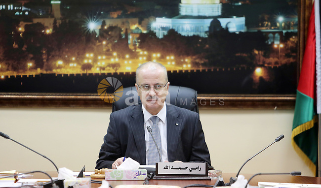 Palestinian Prime Minister, Rami Hamdallah, chairs a meeting of the Council of Ministers, in the West Bank city of Ramallah, on June 21, 2016. Photo by Prime Minister Office