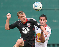 Adam Cristman #7 of D.C. United heads away from Mike Petke #12 of the New York Red Bulls during an MLS match on May 1 2010, at RFK Stadium in Washington D.C.