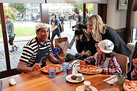 Pictured: Swansea City Football Club defender Ashley Williams at the Pizza Express restaurant in Swansea, learning how to make pizza with children of asylum seekers. Thursday 22 September 2011