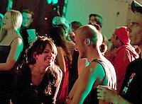 Adherents attending Autonomous spaces fundraiser, Easton Community Centre, Kilburn Street, Easton, Bristol, Dec 2010.