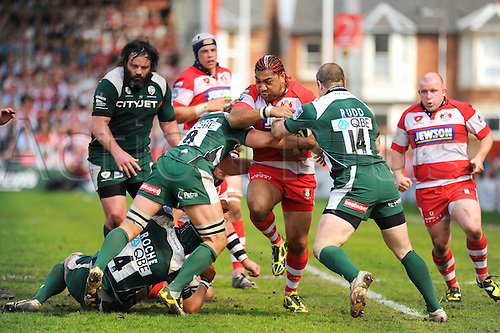 GLOUCESTER, UNITED KINGDOM, APRIL 24 2010:Gloucester's Lesley Vainkolo powers through tackles in the Guinness Premiership rugby match between Gloucester Rugby and London Irish at Kingsholm Stadium, Gloucester, United Kingdom.