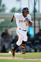 GCL Pirates outfielder Edison Lantigua (31) runs to first during the first game of a doubleheader against the GCL Yankees 2 on July 31, 2015 at the Pirate City in Bradenton, Florida.  GCL Pirates defeated the GCL Yankees 2 2-1.  (Mike Janes/Four Seam Images)