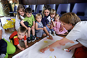 'Planning for Real' exercise at a mothers' and toddlers' group in Jaywick Sands, Essex.  Many of the estate's flimsy and delapidated seaside chalets, built as holiday homes, are now being used as permanent housing, privately rented to benefit claimants.