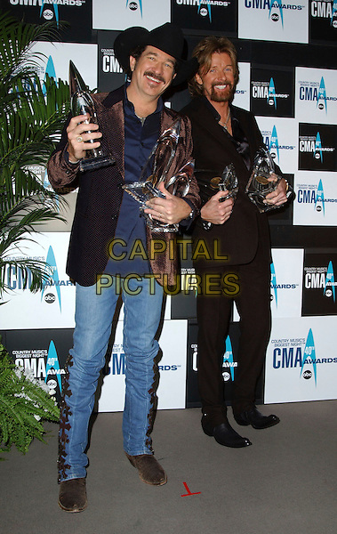 BROOKS & DUNN.40th Annual CMA Awards held at Gaylord Entertainment Center, Nashville, Tennessee , USA.November 6th, 2006.Ref: ADM/GS.full length awards trophies trophy jeans denim jacket brown black hat  .www.capitalpictures.com.sales@capitalpictures.com.©AdMedia/Capital Pictures.