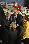 (L-r) Democratic Congressman Charlie Rangel of New York, Attorney General nominee Eric Holder, and his wife Sharon Malone talk with an unidentified woman at the luncheon following Barack Obama's swearing in as the 44th President of the United States at Statuary Hall in the U.S. Capitol in Washington, DC on January 20, 2009.