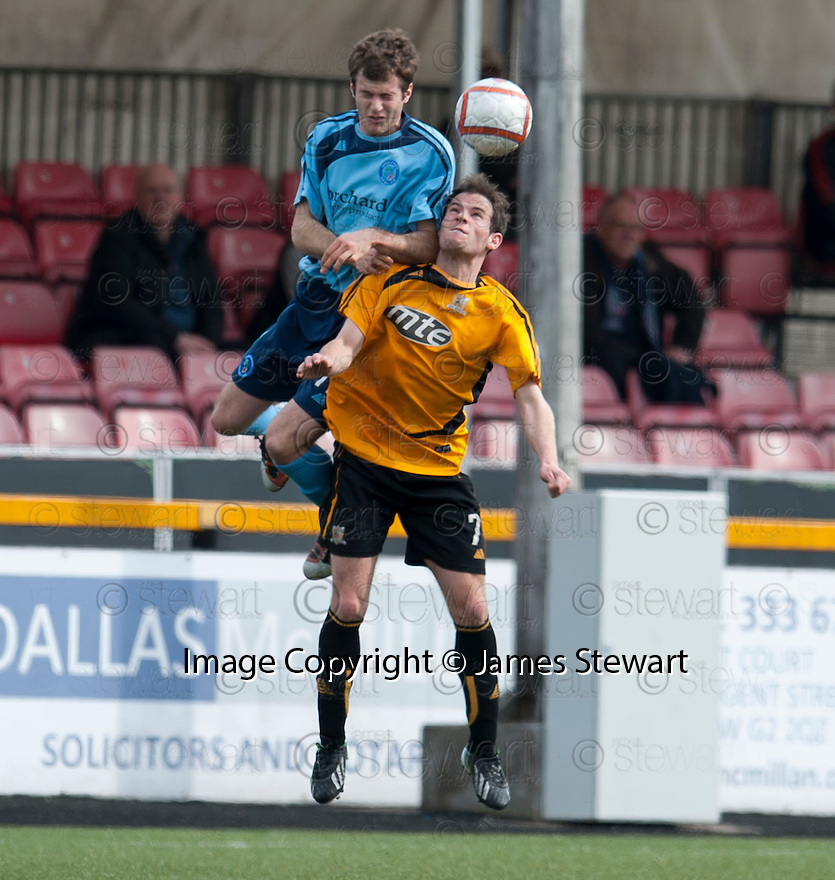 Forfar's Danny Denholm goes over the top of  Alloa's Kevin Moon.
