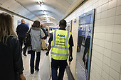 ABM Cleaning Services contract worker at Bond Street tube station, London.