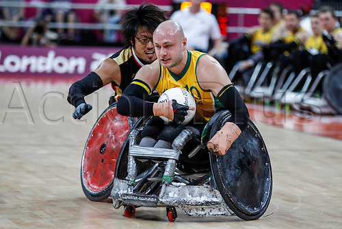 08.09.2012 London, England. Chris BOND (AUS) on the ball during his team's semi-final against Japan in the wheelchair rugby competition from The Basketball Arena in the Olympic Park, Stratford, London on Day 10 of the 2012 Paralympic Games.  Final score: Great Britain 38-49 Japan.  Japan advance to the semi-finals.