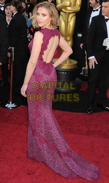 SCARLETT JOHANSSON .arriving at the 83rd Annual Academy Awards at the Kodak Theatre in Los Angeles, California, USA,.February 27th, 2011..oscars arrivals full length dolce & gabbana dress purple lace backless cut out back rear behind long maxi hand on hip looking over shoulder  .CAP/ROT/TM.©TM/Roth Stock/Capital Pictures