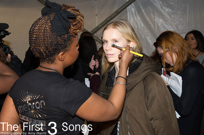 A model prepares backstage for the Charlotte Ronson fashion show during Mercedes-Benz Fashion Week Fall 2015 at Lincoln Center in New York City.