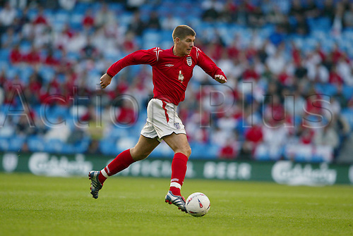 1 June 2004: England midfielder Steven Gerrard runs with the ball during the friendly International between England and Japan played at The City of Manchester Stadium. The game finished in a 1-1 draw. Photo: Neil Tingle/Action Plus..040601 soccer football player players footballer footballers
