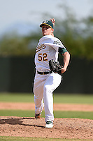 Oakland Athletics pitcher Brett Graves (52) during an Instructional League game against the San Francisco Giants on October 15, 2014 at Papago Park Baseball Complex in Phoenix, Arizona.  (Mike Janes/Four Seam Images)