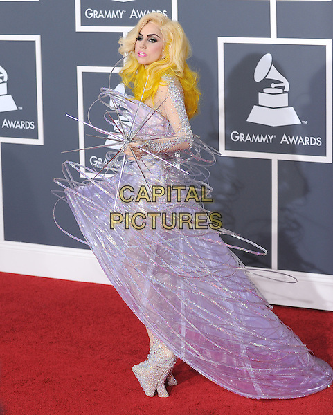 LADY GAGA (Stefani Joanne Angelina Germanotta).Arrivals at the 52nd Annual GRAMMY Awards held at The Staples Center in Los Angeles, California, USA..January 31st, 2010.grammys full length purple dress wire platform silver beads beaded dress shoes sparkly spike side .CAP/RKE/DVS.©DVS/RockinExposures/Capital Pictures