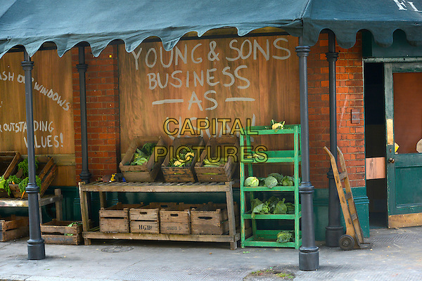 Young &amp; Sons<br /> Filming on the set of 'Fleming' where Dominic Cooper stars as Ian Fleming, Central London, England.<br /> 29th June 2013<br /> tv mini series vegetables food business as usual shop shelf shelves gv general view<br /> CAP/IA<br /> &copy;Ian Allis/Capital Pictures