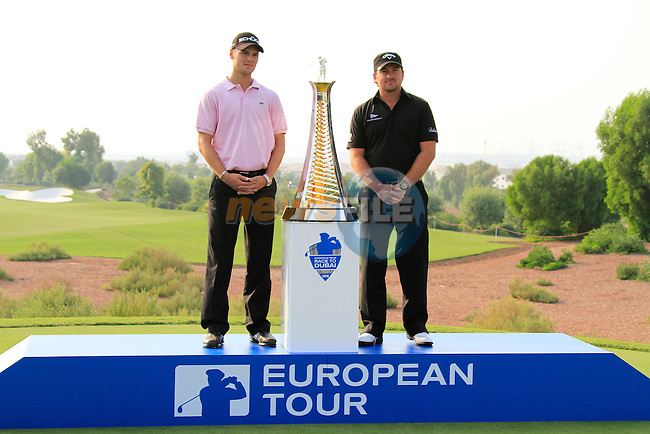 Race to Dubai contenders Graeme McDowell and Martin Kaymer pose with the trophy during Practice Day 1 of the Dubai World Championship, Earth Course, Jumeirah Golf Estates, Dubai, 23rd November 2010..(Picture Eoin Clarke/www.golffile.ie)