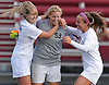 Kaitlyn Larsson #99, Garden City goalie, center, celebrates with teammates Kelly George #15, left, and Julia Kavan #13 after a 1-0 win over North Shore in the Nassau County Class A varsity girls soccer quarterfinals at Garden City High School on Wednesday, Oct. 26, 2016.