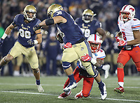 Annapolis, MD - November 11, 2017: Navy Midshipmen fullback Anthony Gargiulo (38) gets tackled by Southern Methodist Mustangs defensive back Cedric Lancaster (3) during the game between SMU and Navy at  Navy-Marine Corps Memorial Stadium in Annapolis, MD.   (Photo by Elliott Brown/Media Images International)