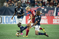 FOXBOROUGH, MA - SEPTEMBER 21: Andrew Farrell #2 of New England Revolution comes in to tackle Kelyn Rowe #6 of Real Salt Lake during a game between Real Salt Lake and New England Revolution at Gillette Stadium on September 21, 2019 in Foxborough, Massachusetts.