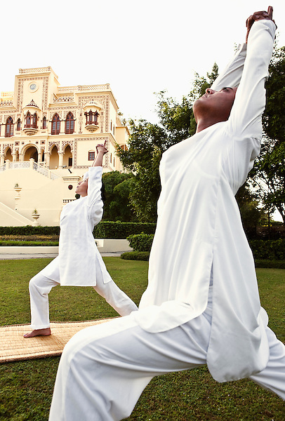 A private yoga lesson in front of the Maharajah's Palace, Ananda in the Himalayas, The Palace Estate, Narendra Nagar, Tehri Garhwal, Uttarakhand, India.