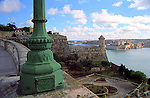 green lampost turret and port Grand Harbour in Valletta island of Malta Europe