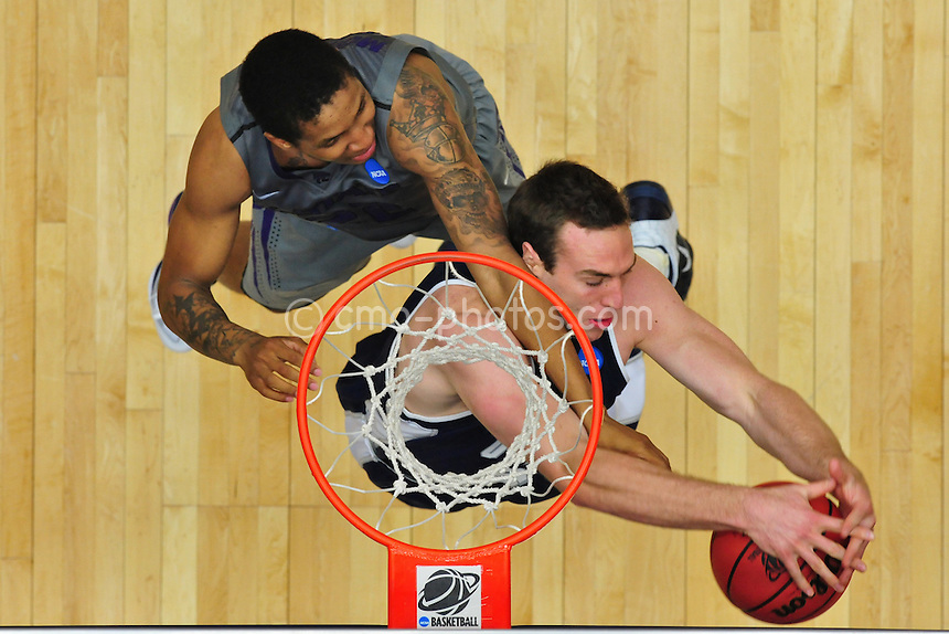 Mar 17, 2011; Tucson, AZ, USA; Utah State Aggies forward Nate Bendall (35) and Kansas State Wildcats guard Rodney McGruder (22) fight over a rebound in the second half of a game in the second round of the 2011 NCAA men's basketball tournament at the McKale Center.