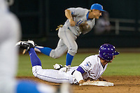 LSU Tiger pinch hitter Tyler Moore (2) dives back to second base as the UCLA Bruins attempt the hidden ball trick in the ninth inning of Game 4 of the 2013 Men's College World Series against the UCLA Bruins on June 16, 2013 at TD Ameritrade Park in Omaha, Nebraska. UCLA defeated LSU 2-1. (Andrew Woolley/Four Seam Images)